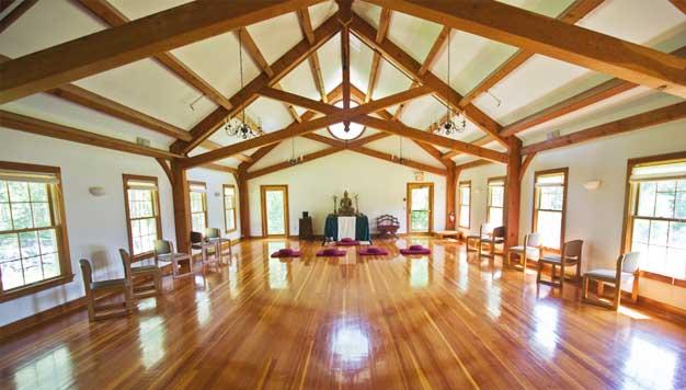 Douglas Fir timber frame scissors truss spans a large area.